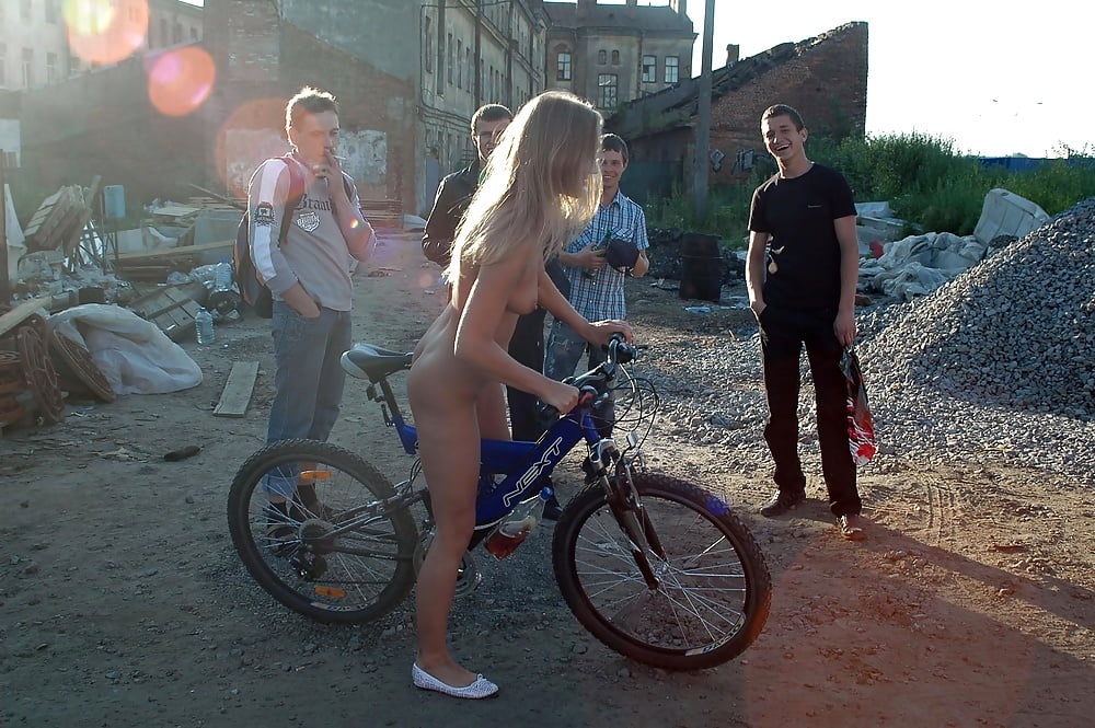 Jeannie santiago posing nude with a bike