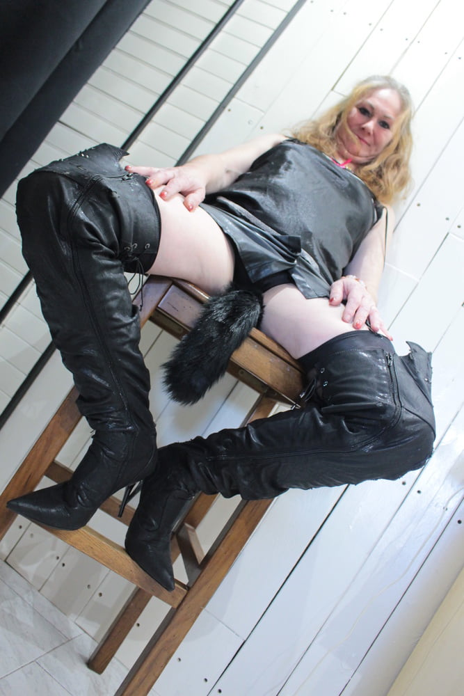 Leather skirt with boots and satin top- 23 Pics