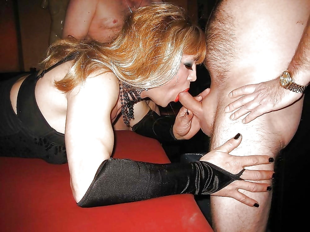 Two cock sucking crossdressers take mouthfuls of cock in this gr
