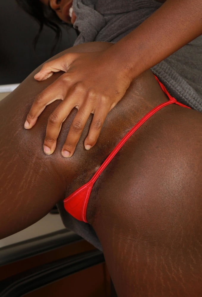 Tight ebony gf takes a self shot in pulled down panties