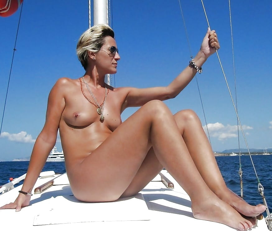 Nude young girl sailing over the world