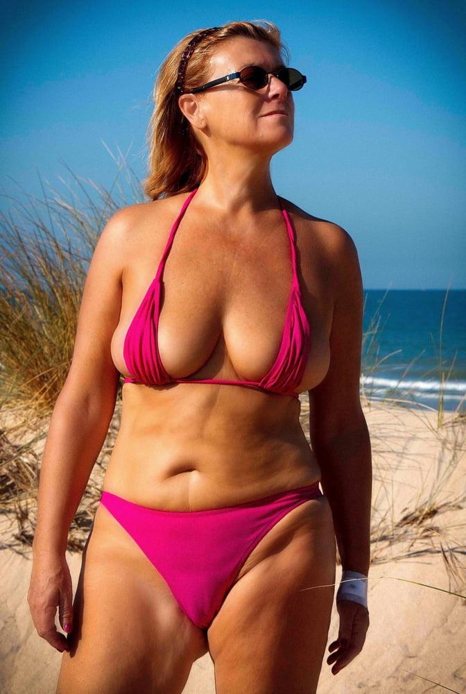 Mature bikini thumbs