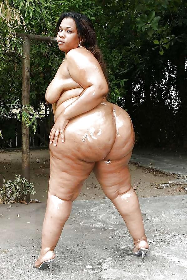 Cute curvy latina woman towel dries stock photo