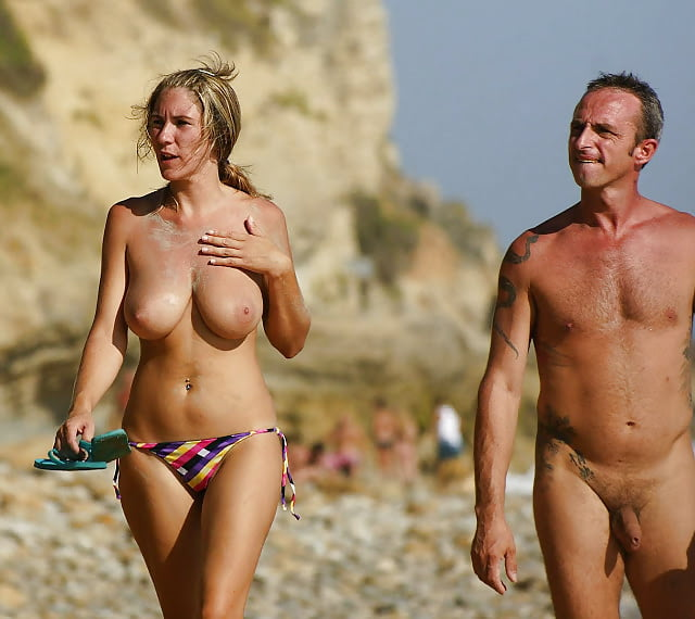 Nude men and women on beach photos