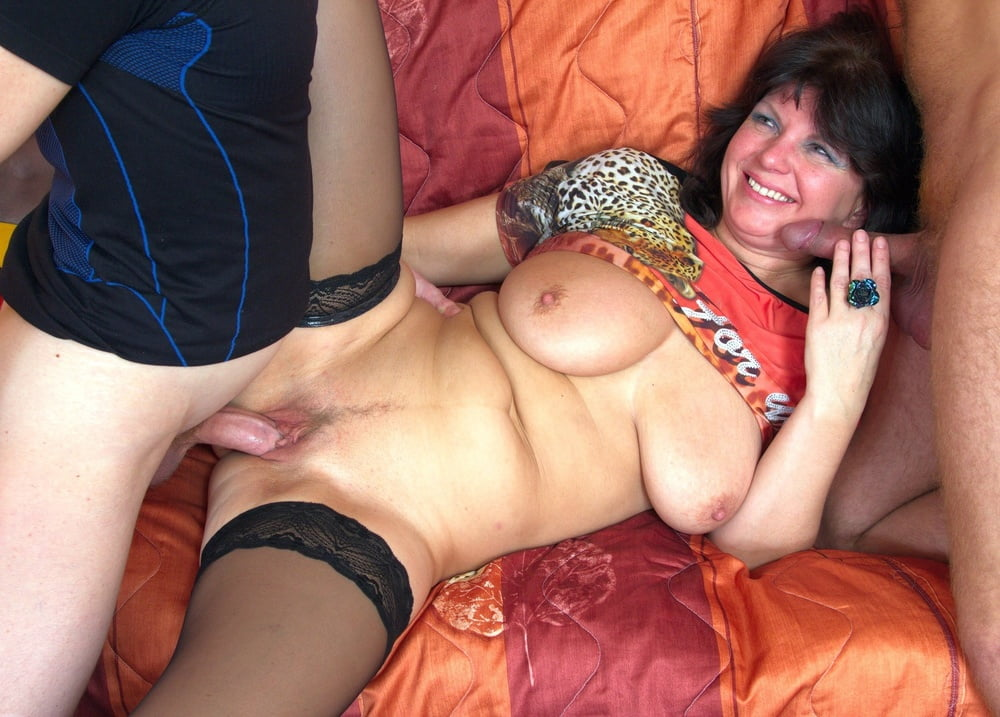 Mature slut with big hanging breasts satisfies two young guys