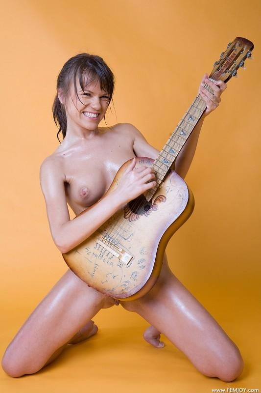 Naked female playing instruments — 6