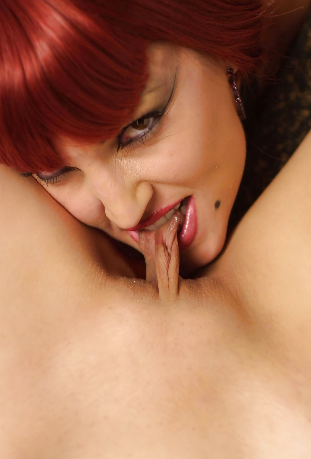 Biting her pussy lips — pic 2