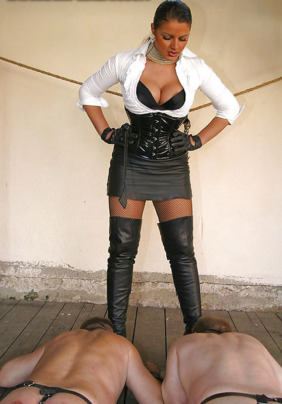 Captured by a shemale mistress dressed in black nylons