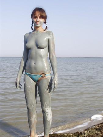 Naked girls in mud