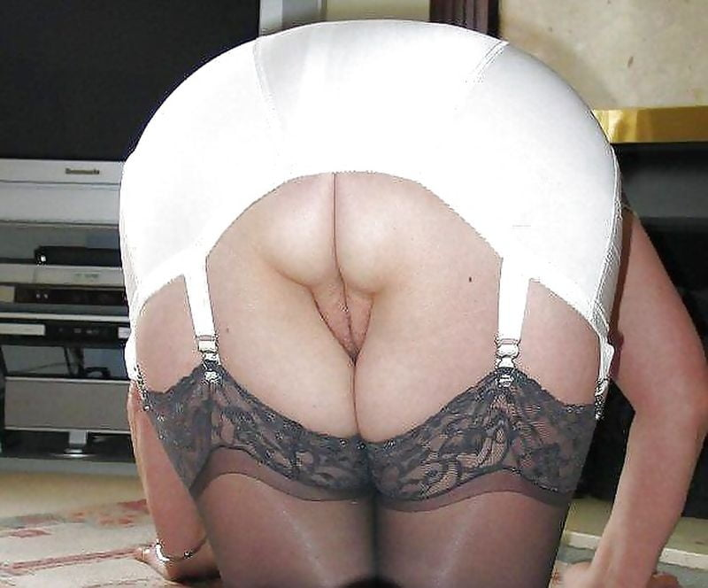 A Glimpse Of Her Pussy Under The White Girdle