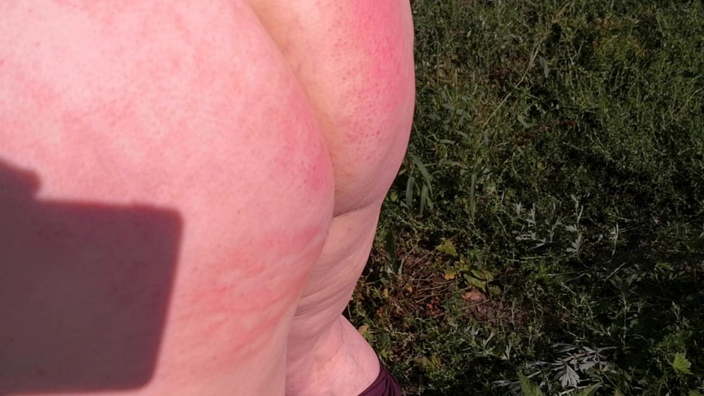 Naked whipping in cornfield - 18 Pics