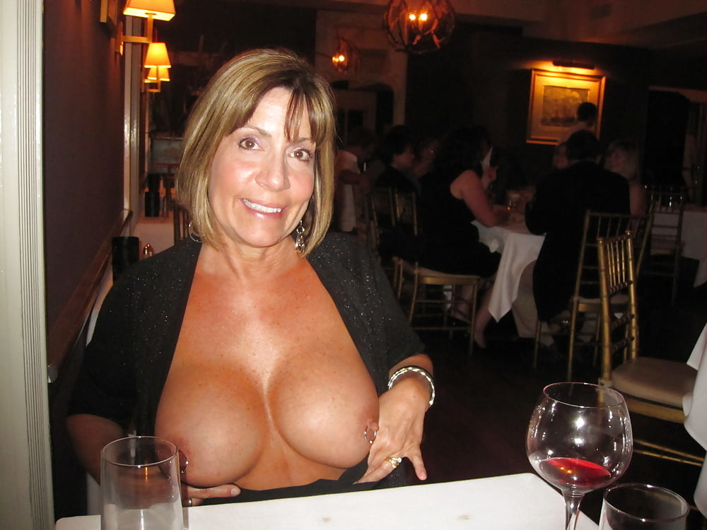 Sexy mature woman showing their huge tits