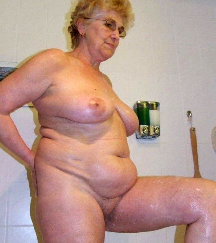 Big buxom gray hair granny laughing nude in shower