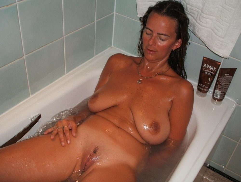 Naked women getting out of shower