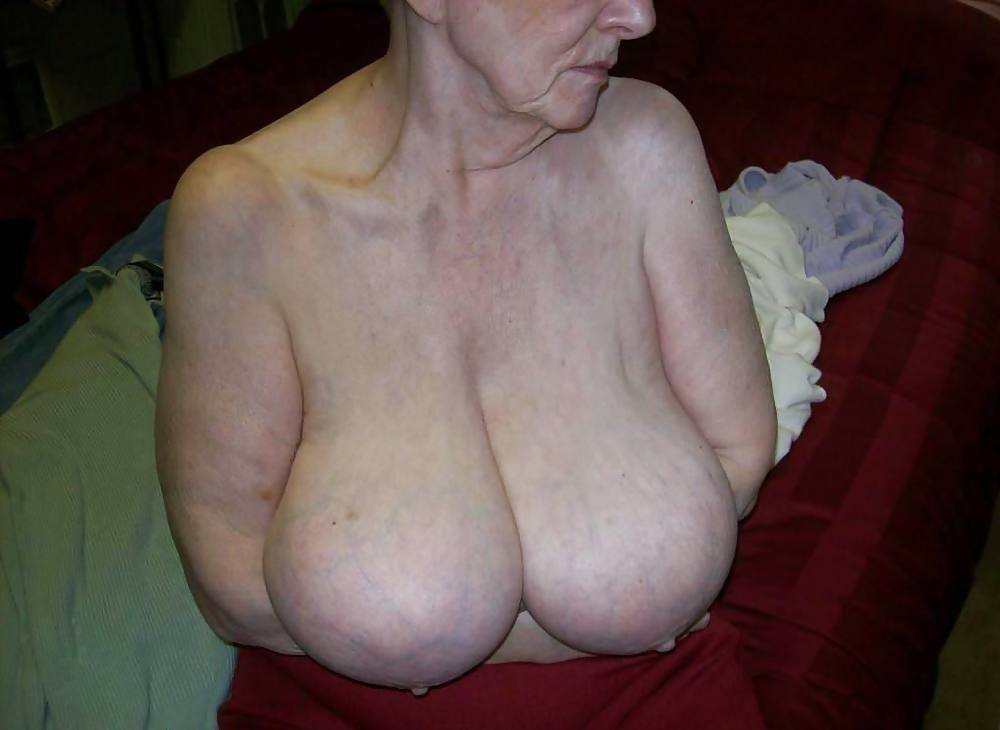 Slim Stacked Grandma With Oversized Natural Tits Lotions Up And Shows Off Big Saggy Udders