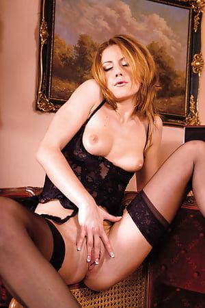 gilda roberts posing in black stockings and heels