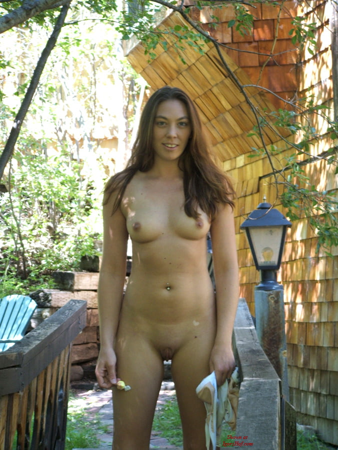 Mature woman nude backyard sunbathing