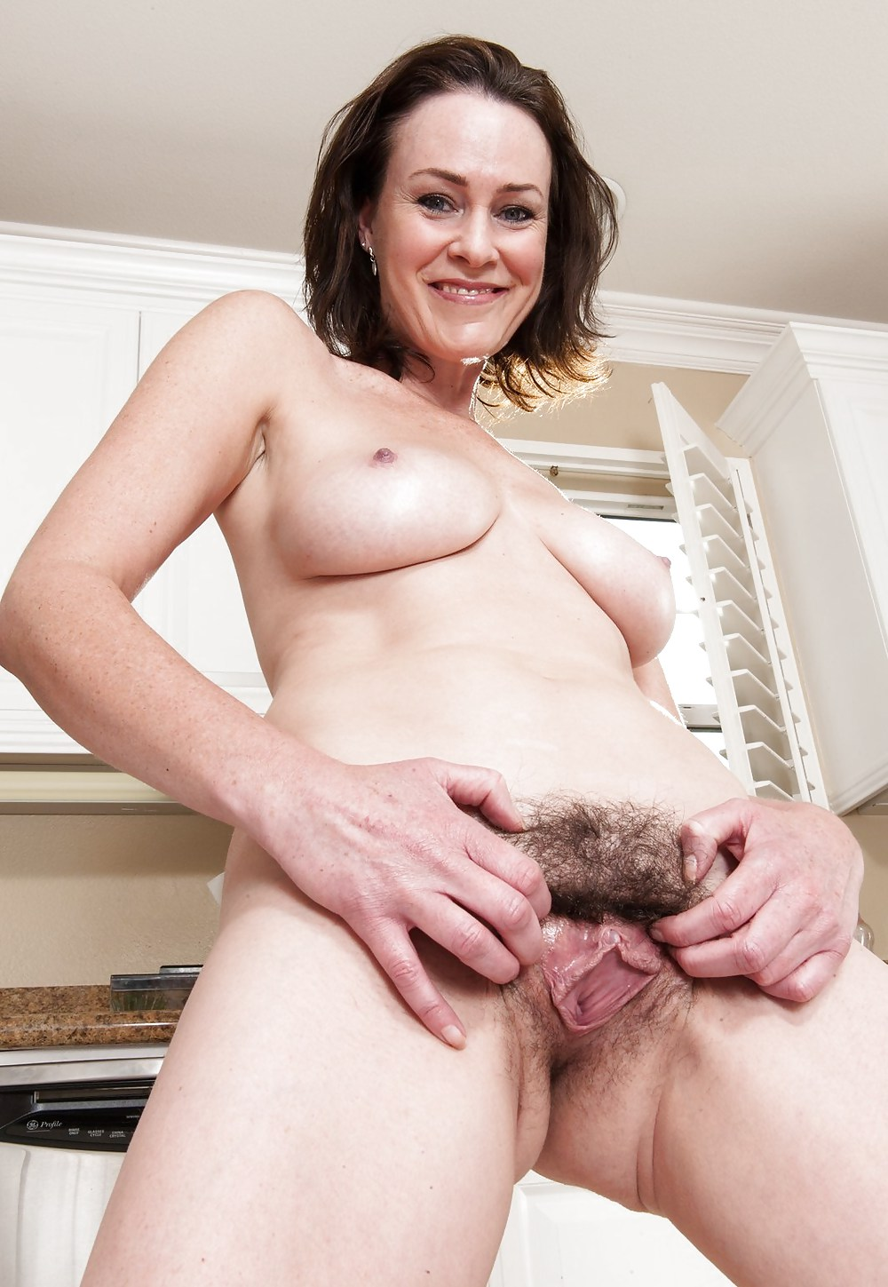 mature-brunette-with-hairy-pussy-thumbs