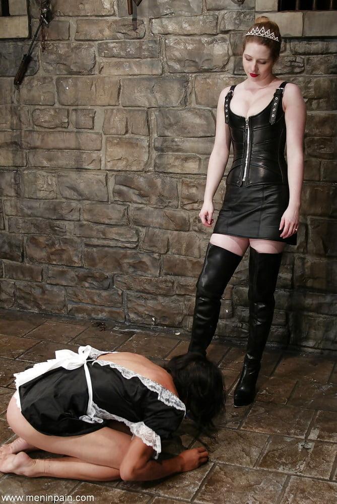 Mistress fucks her maid