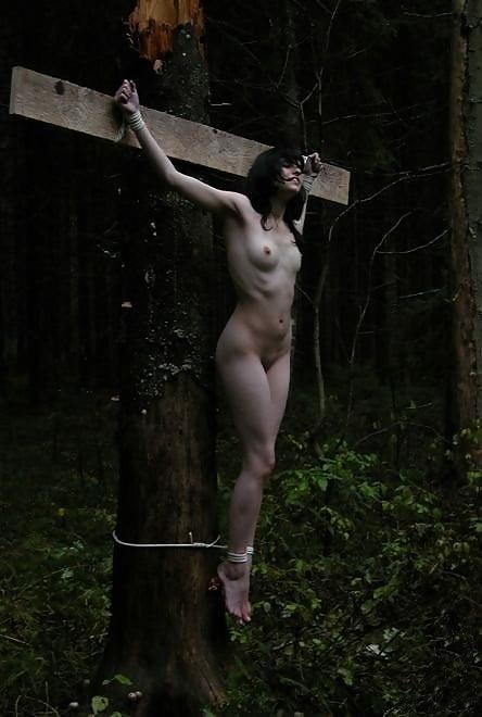 Nude asian girl crucified