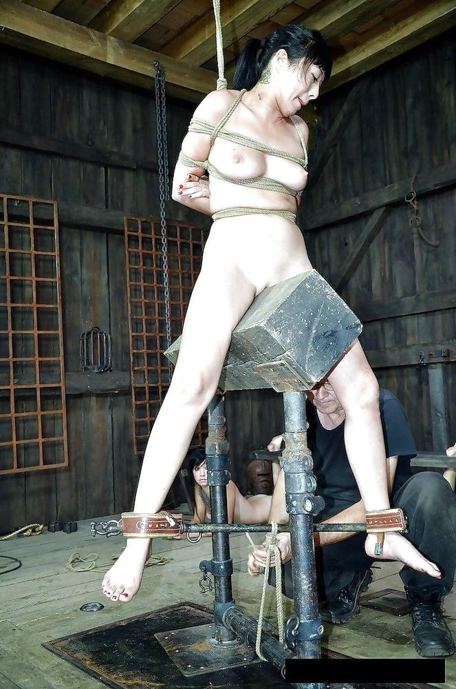 Wood dildo torture