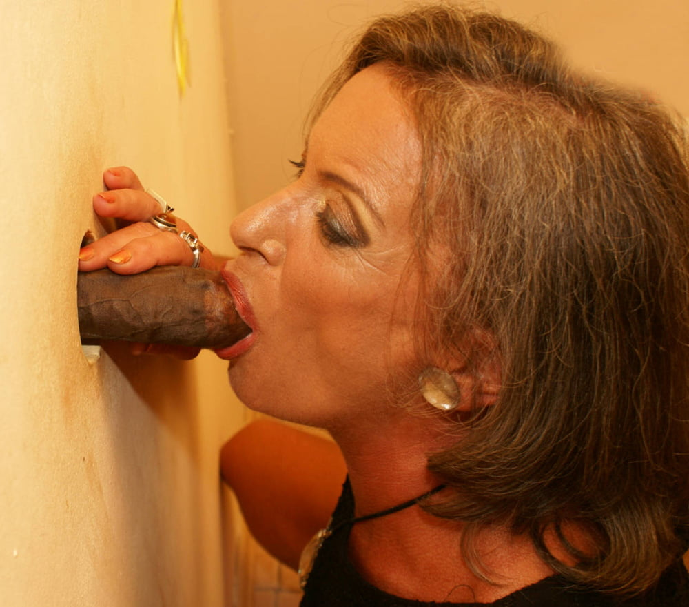 Blonde milf just loves to suck cock through glory hole
