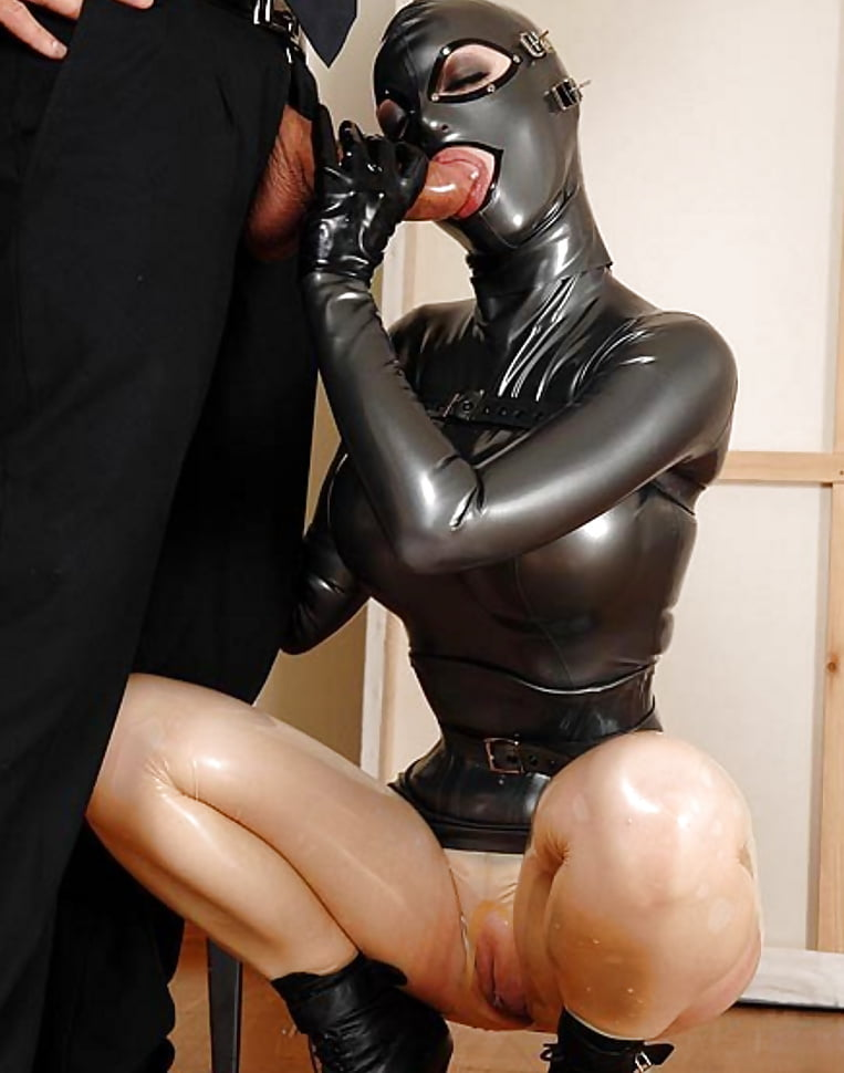 Angela In A Satin Blouse And A Long Leather Skirt With Handcuffs And A Wristwatch