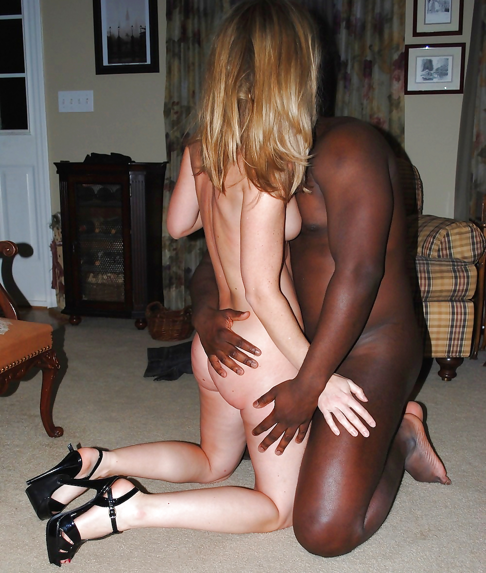 Slut in high heels sucks big black cock