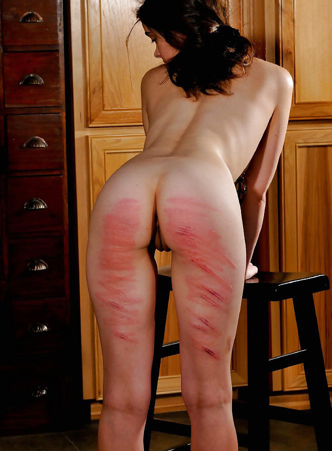 Michaela caned nude spanking wall