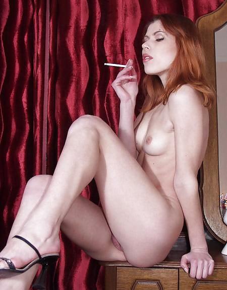 Sexy redhead nude smoking — img 1