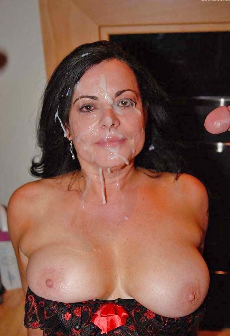 Mature older woman licking cum