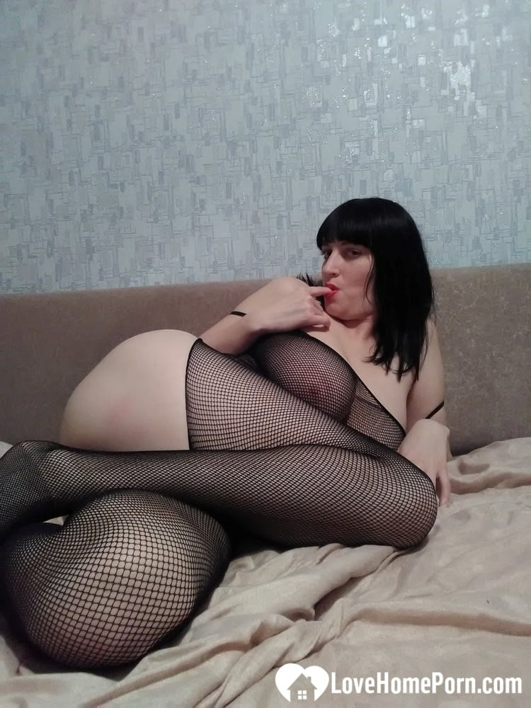 Desirable stepmom in a fishnet outfit loves teasing - 62 Pics
