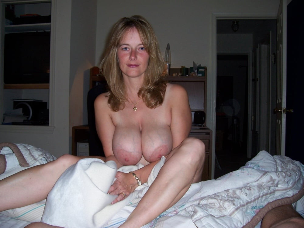 Amateur blonde with big natural tits in her first porn photo