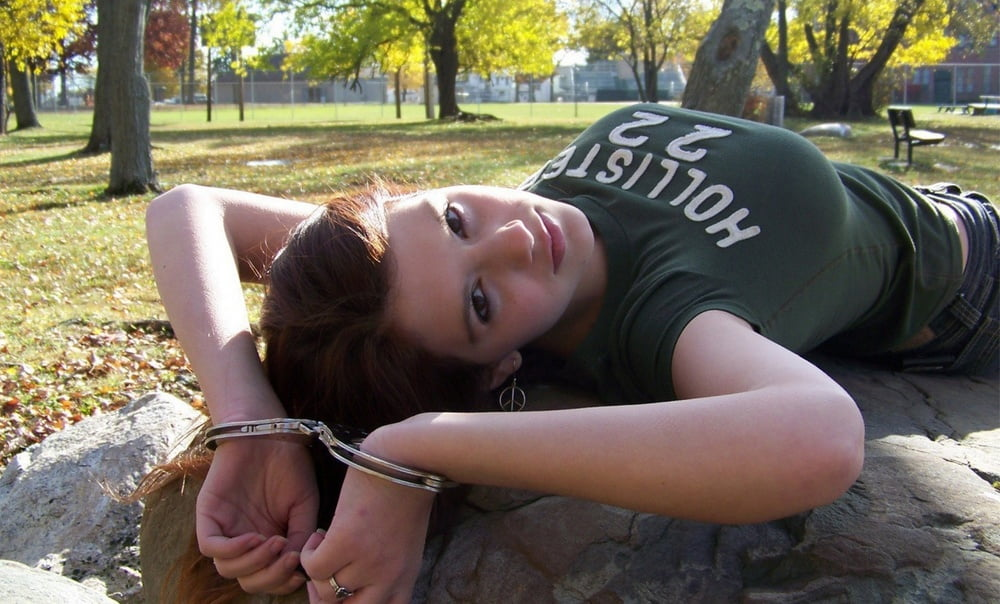 Cute young girlfriend ball gagged, blindfolded and handcuffed outside