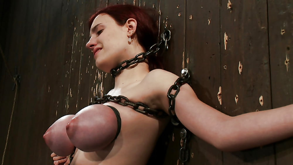 Chick That Is Chained To The Wall Gets Wet