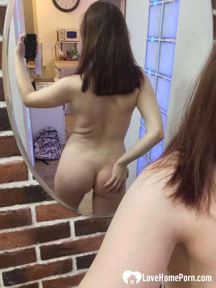 Devilish cutie posing nude for a mirror - 65 Pics