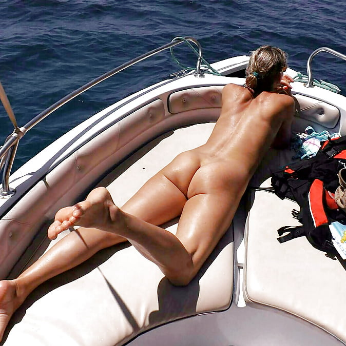 Mature nude women on boats