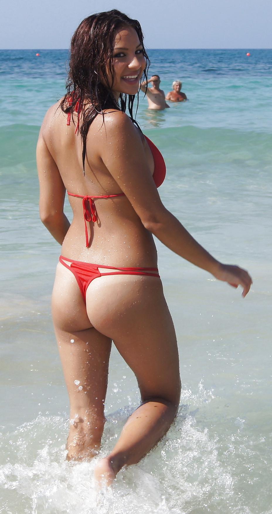 Girl pops out of bikini — 14