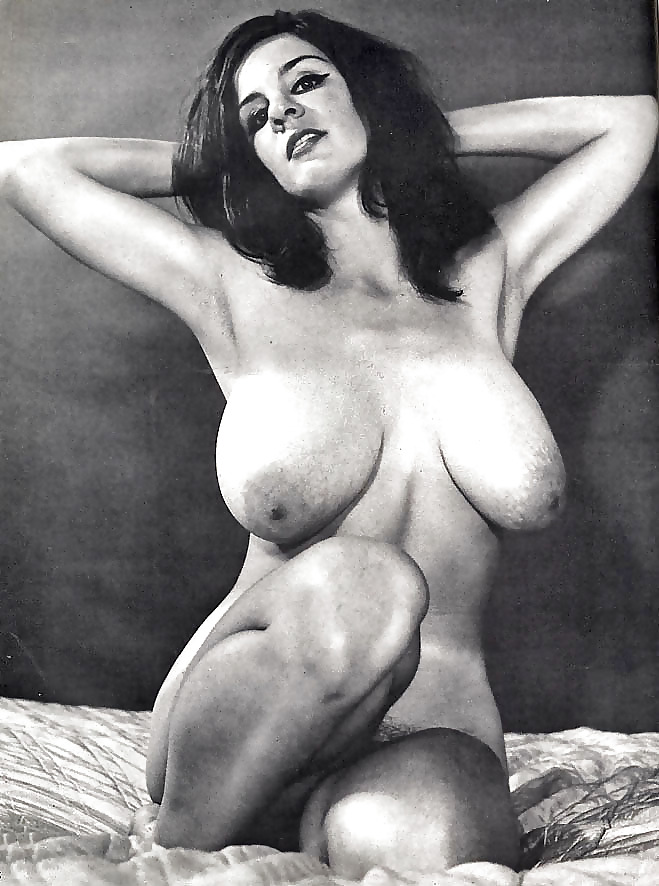 Vintage pic of a young big tits woman in stockings