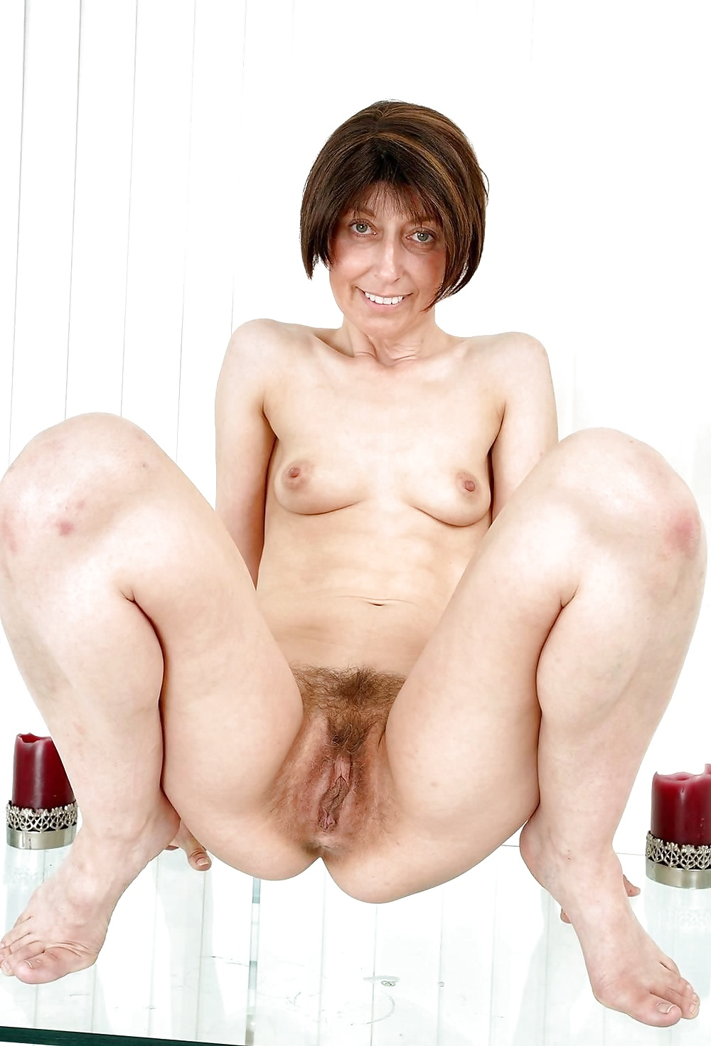 Mature slut with saggy boobs and hairy pussy fucked doggystyle
