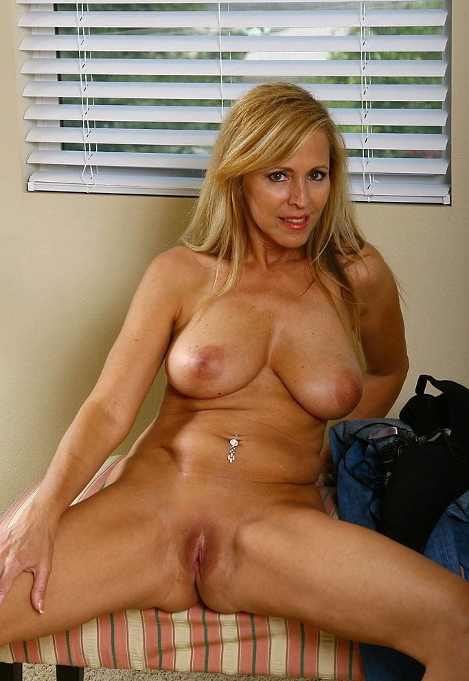 Blonde Cougar Naked On Bed