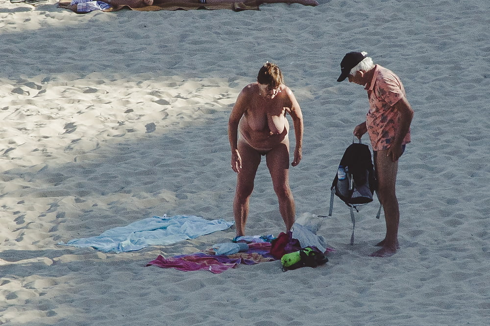 Naked old men on the beach-9971