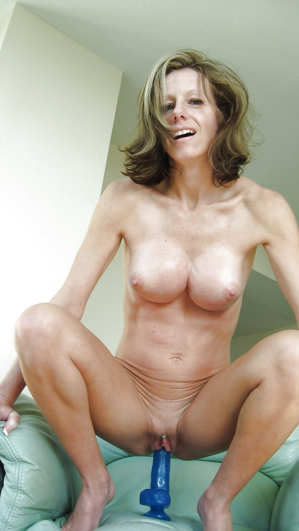 Busty slim nude mature woman 1