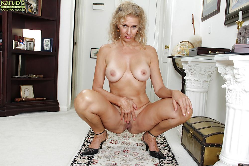 Mature blonde woman looking away, portrait top garment, person