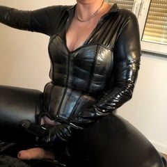 Catsuit, Boots, Corset And Pissing