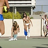 Naked girls playing dodgeball outdoors