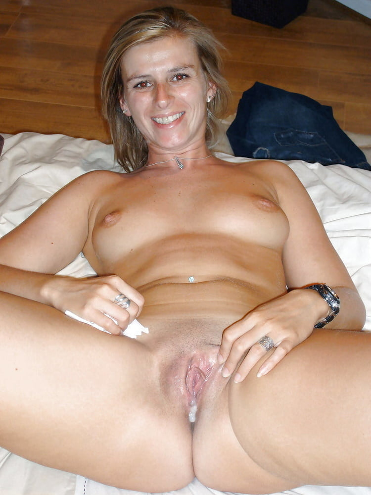 My Wife's Beautiful, Tight Shaved Pussy Porn Pic