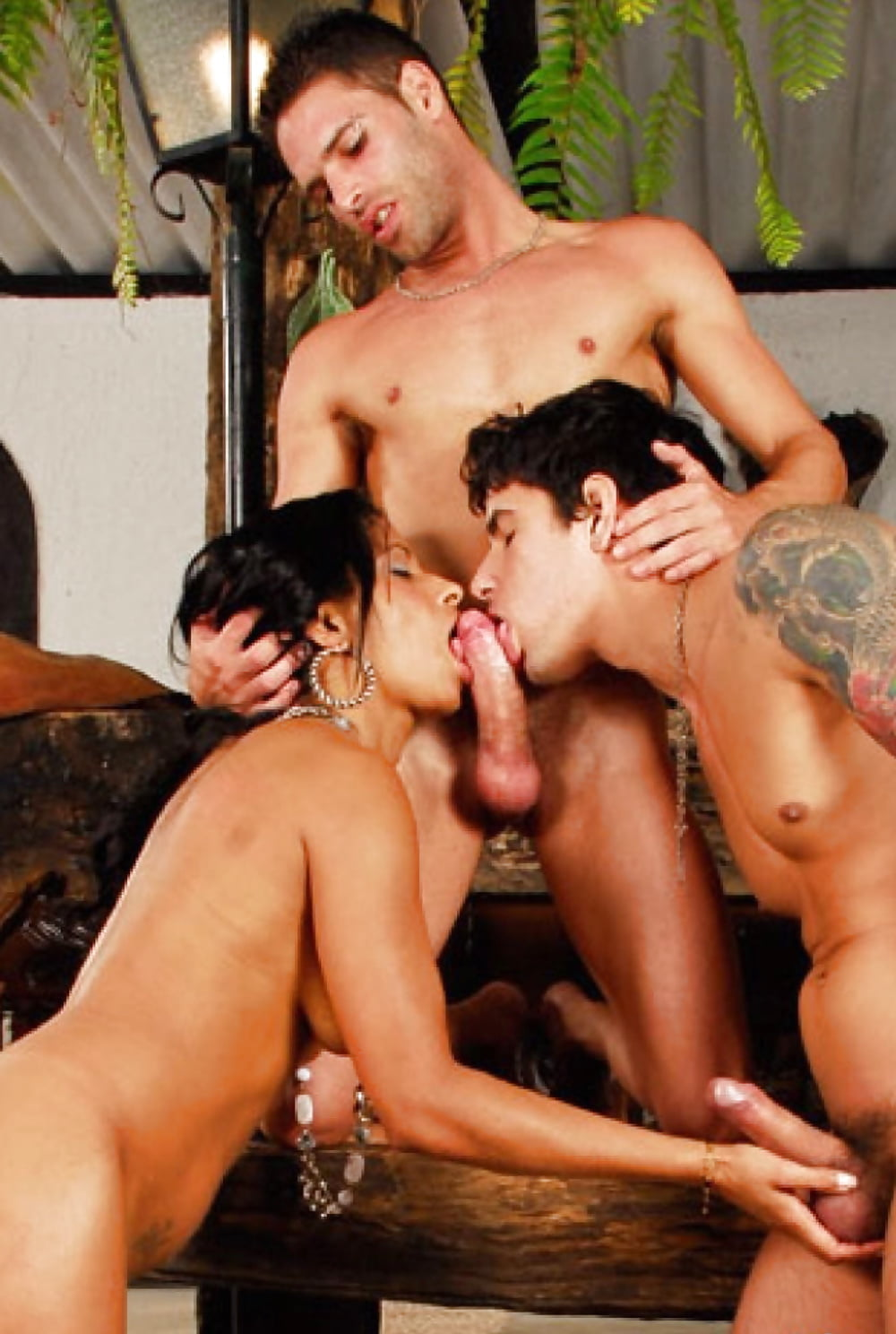 Thick black girl and three guys in bisexual photo