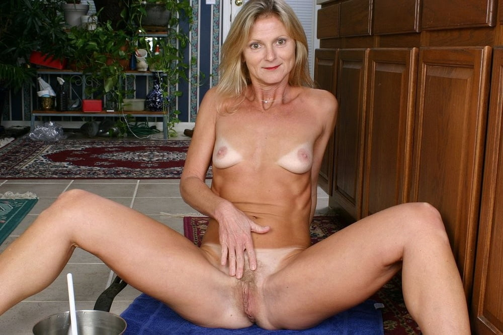 Thin amateur milf, woman sitting on a table for sex