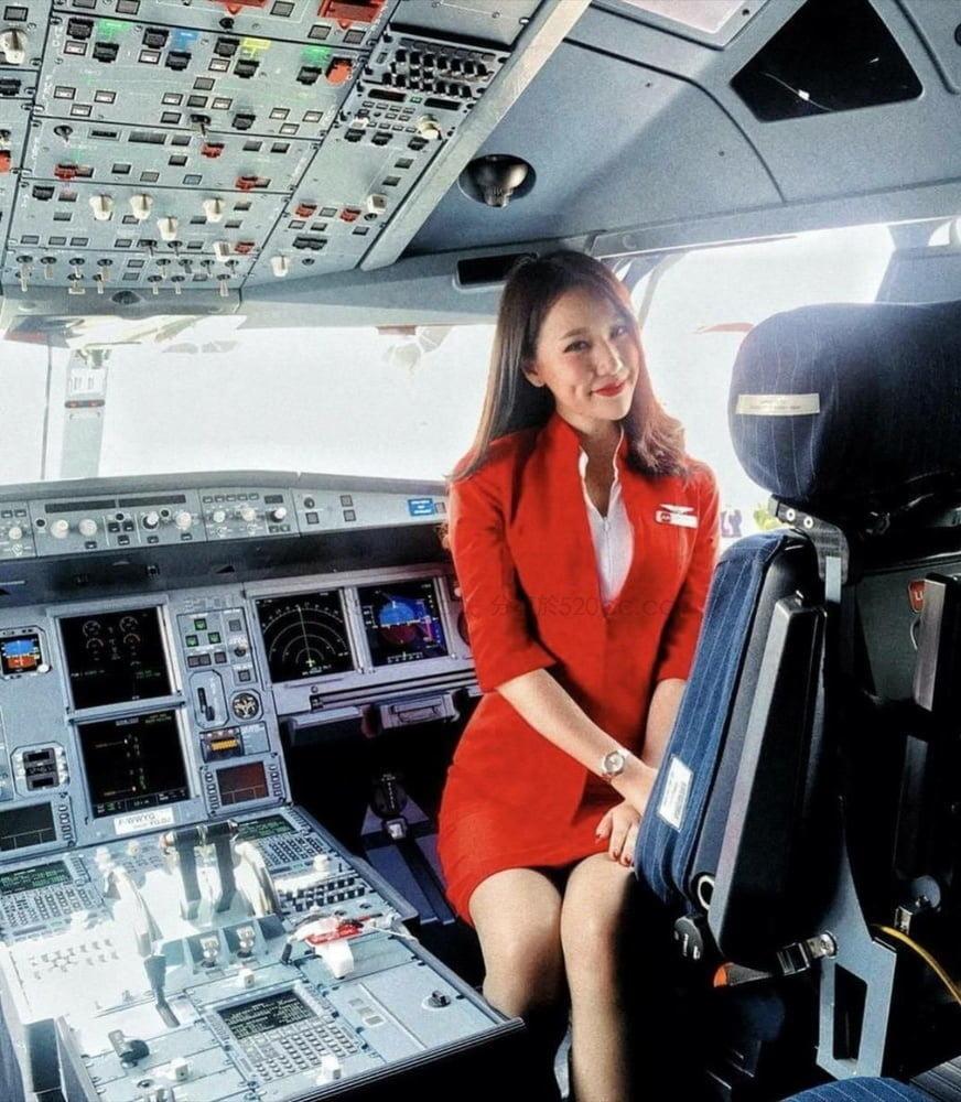 Sexy Flight Attendant - 9 Pics